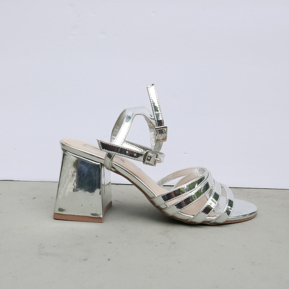 7fcc604702c Forever 21 Shoes - Metallic Silver Sandal Strap Block Heels